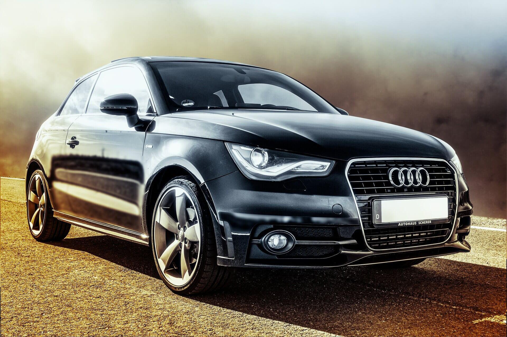 Dramatic photograph of an black Audi car.
