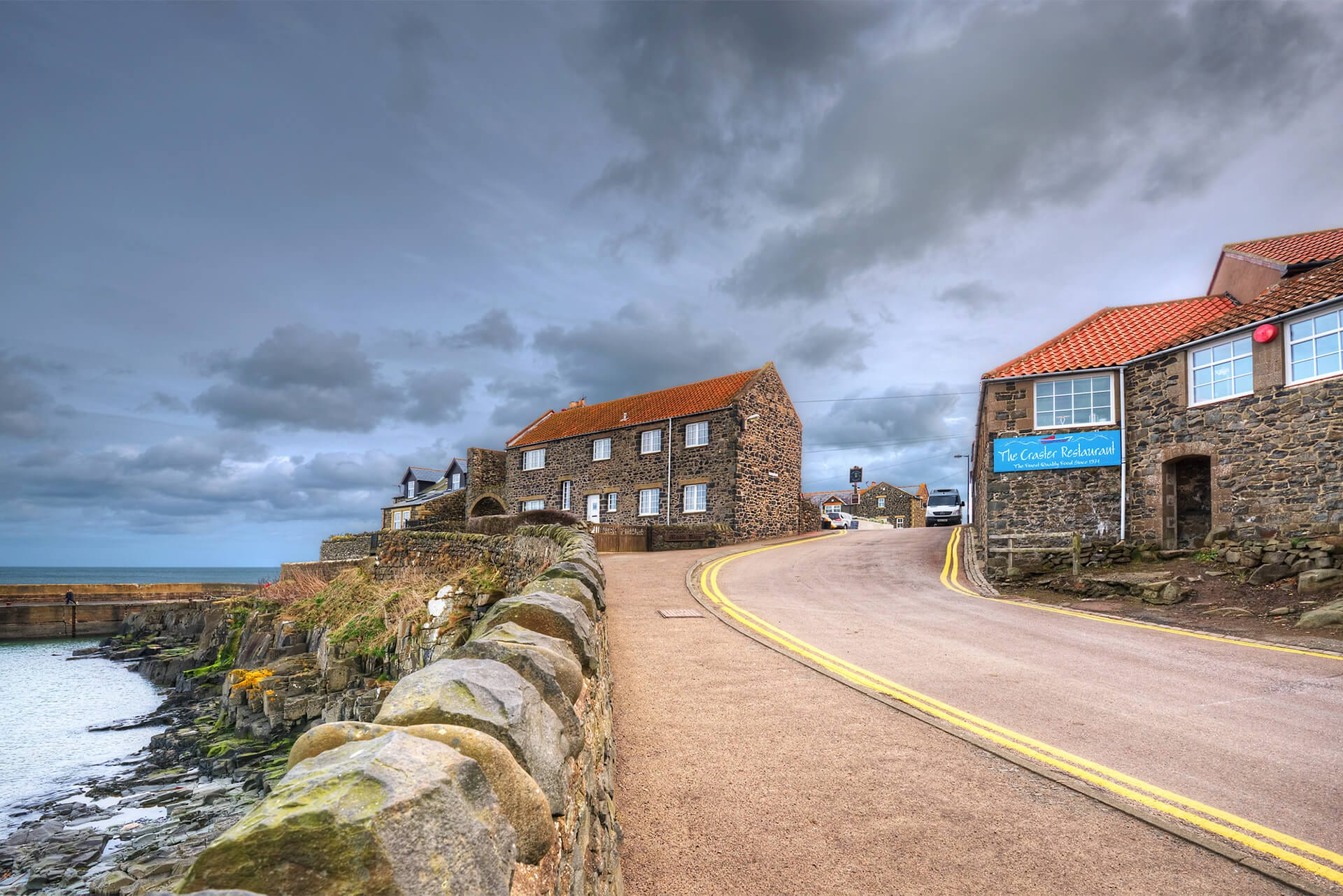 A view of The Craster Restaurant from the bottom of the hill in Craster, Northumberland
