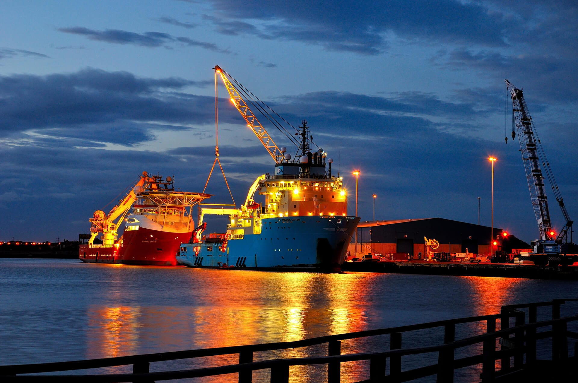 Container ships being loaded at dusk from the Port of Blyth, Northumberland